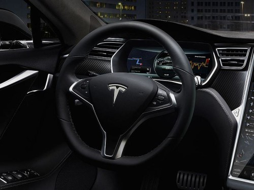 Tesla Courts Hackers to Defend High-Tech Cars