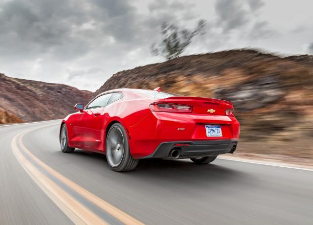 2016-Chevrolet-Camaro-RS-rear-three-quarter-in-motion