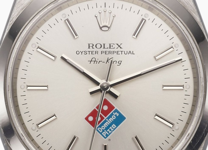 Why Is There a Domino's Logo on This Rolex?