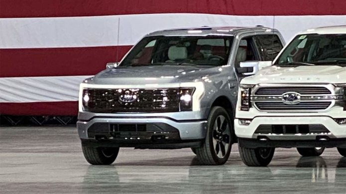 2022 F-150 Lightning pickup spied in the background during a presidential visit