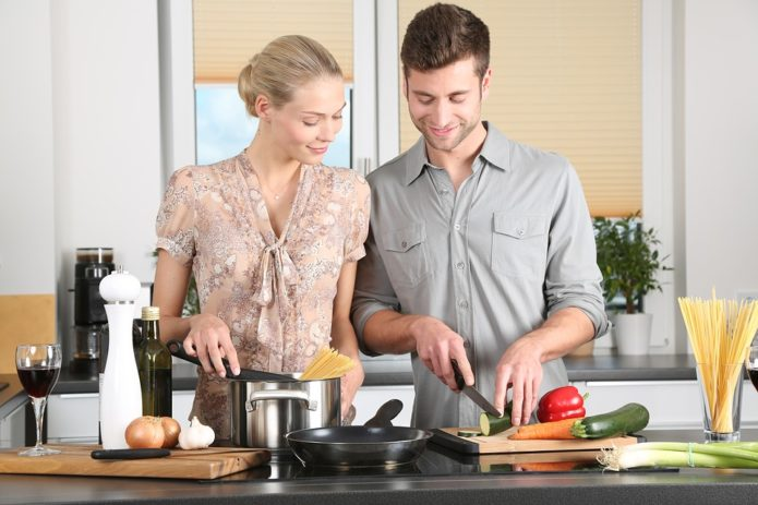 woman and man cooking